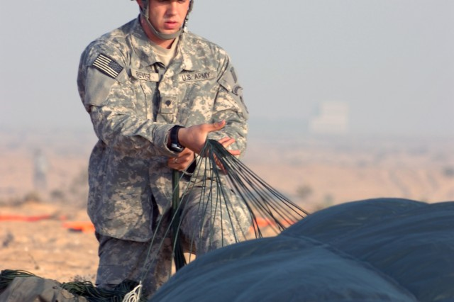 Spc. Shawn Brewer, 1st Battalion, 325th Airborne Infantry Regiment, 2nd Brigade Combat Team, 82nd Airborne Division, packs his parachute after jumping out of a C-17 as part of a coalition friendship jump during Operation Bright Star 2009. Bright Star is a multinational exercise that is designed to improve readiness, interoperability and strengthen military and professional relationships among other nations.