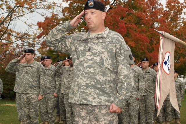 1st Sgt. Jeffery Burnsworth, former first sergeant for the 3d Sustainment Command (Expeditionary) Headquarters and Headquarters Company and Fairmont, W.Va., native, salutes the American flag with his Soldiers during a change of responsibility ceremony at Fort Knox, Ky., Oct. 13.  U.S. Army photo by Spc. Michael Behlin.