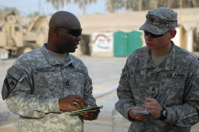 BAGHDAD - Brooklyn, N.Y. native, Staff Sgt. Aussie Barker (left), team chief assigned to Company B, 2nd Battalion, 5th Cavalry Regiment, 1st Brigade Combat Team, 1st Cavalry Division, and Sebring, Fla. Native, Sgt. Jessie Rowe, shop foreman also assigned to Co. B, discuss the days accomplishments at Joint Security Station War Eagle, Oct. 16.