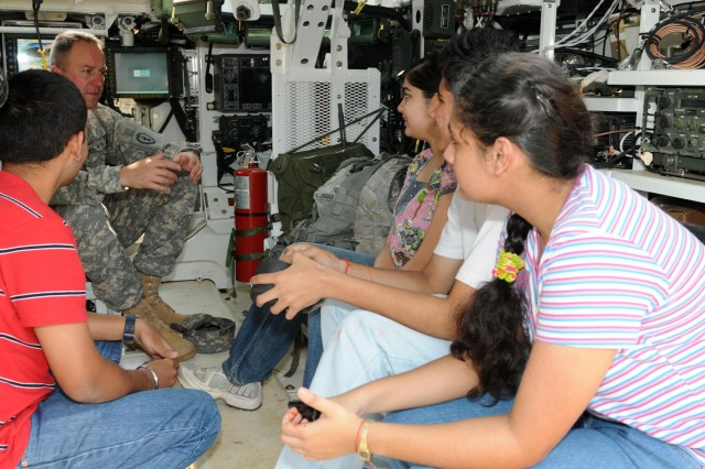"""CAMP BUNDELA, India (Oct. 17, 2009) - Lt. Col. James Isenhower, commander, 2nd Squadron, 14th Cavalry Regiment, """"Strykehorse,"""" 2nd Stryker Brigade Combat Team, 25th Infantry Division talks with family members of Soldiers assigned to the Indian Army's 31st Armored Division, about the Stryker vehicle their visit to Camp Bundela during Exercise Yudh Abhyas 09 in Babina India, Oct. 17. YA09 is a bilateral exercise involving the Armies of India and the United States. The primary goal of the exercise is to develop and expand upon the relationship between the Indian and U.S. Army.  (Photo by Sgt. 1st Class Rodney Jackson, 18th Medical Command Public Affairs)"""