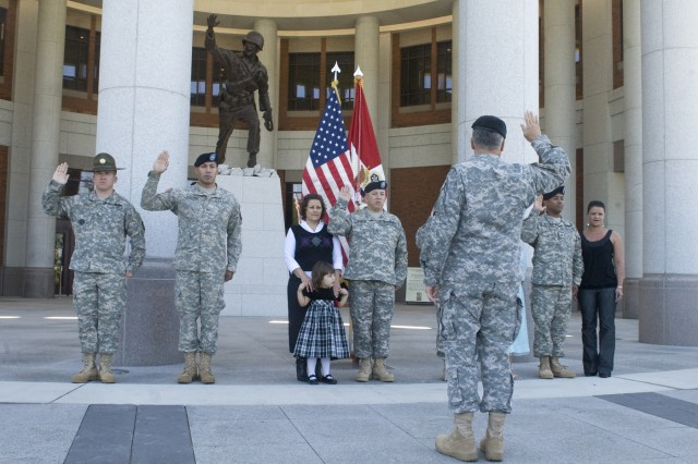 Five Soldiers are reenlisted by the Chief of Staff of the Army, Gen. George W. Casey Jr., in front of the National Infantry Museum in Ft. Benning, Ga., Oct. 20, 2009.