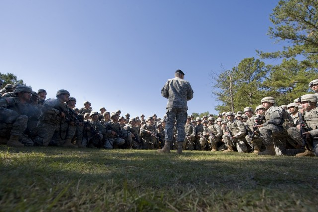 Chief of Staff of the Army, Gen. George W. Casey Jr., addresses a group of Soldiers at the initial entry training course in Ft. Benning, Ga., Oct. 20, 2009.  Casey referenced the Soldiers Creed, Medal of Honor recipient Staff Sgt Jared Monti and the importance of service while addressing the Soldiers.