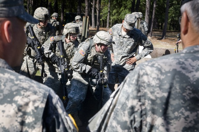 Soldiers at Ft. Benning, Ga., train on proper entry techniques during their urban warfare training while the Chief of Staff of the Army, George W. Casey Jr., observes on Oct. 20, 2009.