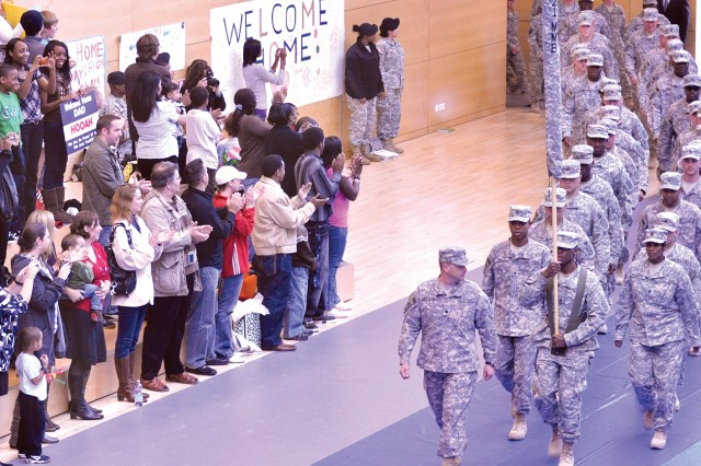 Lt. Col. Noel Cardenas, 421st Multifunctional Medical Battalion commander, leads his Soldiers into the Wiesbaden Fitness Center upon their return from Iraq.