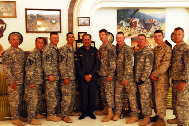 Eight combat veterans stand with Maj. Gen. Fadhil Barwari (center), commander of 1st Brigade, Iraqi Special Operations Forces, and Multi-National Force-Iraq Command Sgt. Maj. Lawrence Wilson (far left) Oct. 16, in Baghdad. The seven wounded Soldiers and wounded Marine took part in the week-long trip to Iraq to visit the places where they served and were injured in support of Operation Iraqi Freedom