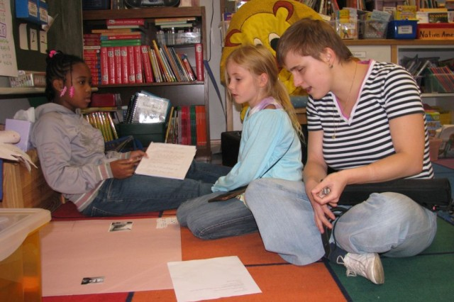 Patrick Henry Elementary School student teacher Isabell Pfeufer listens carefully as students edit their book reports Oct. 2. Pfeufer, who has been blind since birth, completed a three-week practicum with the class in Heidelberg, Germany, in September and October.