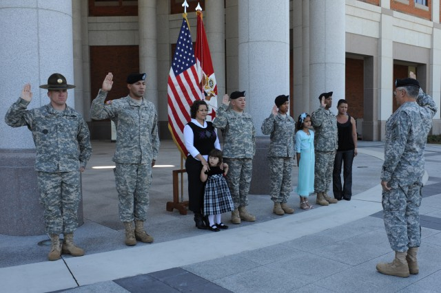 Army Chief of Staff Gen. George W. Casey Jr. re-enlisted five Soldiers and their families during his visit to Fort Benning, Ga., Oct. 20. After the re-enlistment ceremony, which was in front of the National Infantry Museum, Casey spoke to each of the Soldiers and their families. During Casey's visit to the post, he observed one station unit training on Sand Hill, saw the progress in the Base Realignment and Closure construction, preparing the Harmony Church area for the Armor School and Center, and toured the Nationnal Infantry Museum.