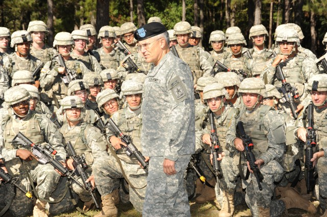 Army Chief of Staff Gen. George W. Casey Jr. talks to Soldiers with C Company, 1st Battalion, 19th Infantry Regiment, 198th Infantry Brigade, about Sgt. 1st Class Jared Monti, who received the Medal of Honor posthumously, and the warrior ethos.  Casey visited Fort Benning, Ga., Oct. 20, to observe Infantry training, view BRAC construction progress and tour the National Infantry Museum for the first time. After the museum tour, Casey re-enlisted five Soldiers and their families in front of the museum's 'Follow Me' statue.