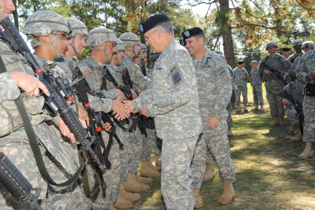 Army Chief of Staff George W. Casey Jr. and Fort Benning Commanding General Maj. Gen. Michael Ferriter, greet Soldiers with C Company, 1st Battalion, 19th Infantry Regiment, 198th Infantry Brigade, during a break in training. Casey visited Fort Benning, Ga., Oct. 20, to observe the training, view BRAC construction progress and tour the National Infantry Museum. After the museum tour, Casey re-enlisted five Soldiers and their families in front of the museum's 'Follow Me' statue.