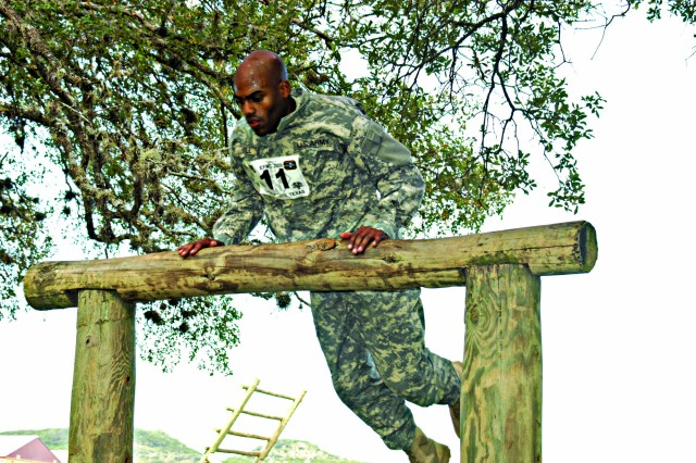 Staff Sgt. Michael A. Hall takes on the belly over obstacle during the Expert Field Medical Competition at Camp Bullis, Texas. Hall is a healthcare specialist at Tripler Army Medical Center, Hawaii.