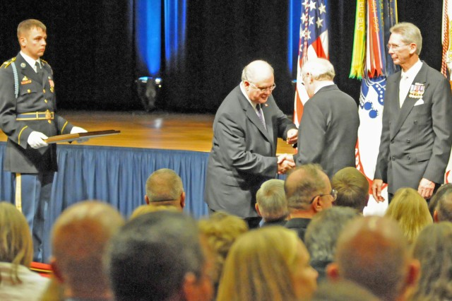 Under Secretary of the Army Dr. Joseph Westphal presents veterans of Troop A, 1st Squadron, 11th Armored Cavalry Regiment, with the Presidential Unit Citation for their heroism in the Vietnam War, during a Pentagon ceremony Tuesday.