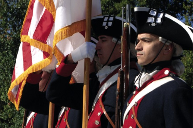 The Continental Color Guard, 3rd U.S. Army Infantry Regiment, Fort Myer, carries the American flag and the colors of the  U.S. Army along Main Street in Yorktown during the Yorktown Day parade Monday. The annual event marked the 228th anniversary of the defeat of British forces under British general Lord Charles Cornwallis at the Battle of Yorktown Oct. 19, 1781. Cornwallis' surrender was the beginning of the end of the American Revolution.
