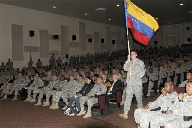 Flags representing the many Hispanic countries are marched down the aisle of Jacobs Theater Oct. 14 during the Hispanic Heritage Celebration. The celebration, put on by the 10th Transportation Battalion, featured traditional Hispanic music and a dancing demonstration.
