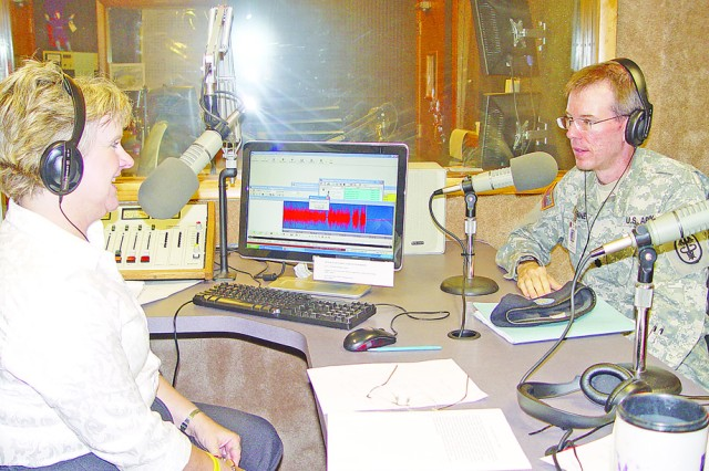 Lt. Col. Paul Benne, IACH Preventive Medicine chief answers questions and concerns of the Central Flint Hills Region community during an interview with Cathy Dawes at KMAN radio in Manhattan Oct. 8.