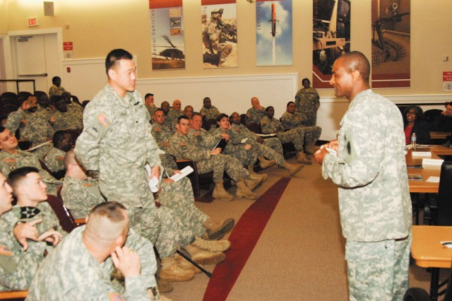 Master Sgt. Walter M. Farrell, senior enlisted advisor for CECOM Life Cycle Management Command (Forward), right, speaks to Soldiers from the Fort MeadeWounded Warrior Program about career opportunities with the CECOM LCMC.