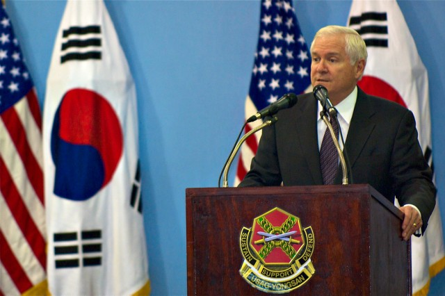 Secretary of Defense Robert Gates addresses a question from a Servicemember during a Yongsan town hall meeting at the Collier Field House Oct. 21.