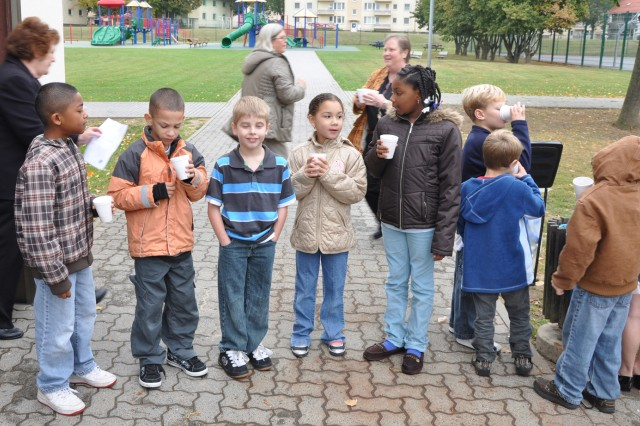 Aukamm Elementary School students enjoy the results of their labor -- fresh-pressed applejuice.