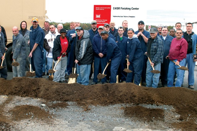 Tobyhanna Army Depot employees break ground for the Command, Control, Communications Computers, Intelligence, Surveillance and Reconnaissance Finishing Center.