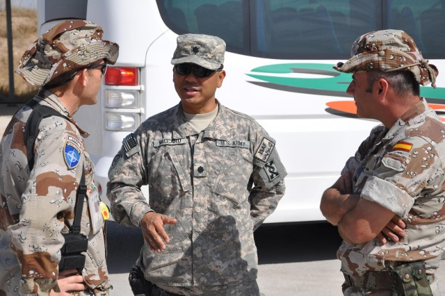 Lt. Col. Thomas Vaccaro discusses with Spanish officers requirements that will accompany the movement of additional U.S. forces to Provincial Reconstruction Team HeartAca,!a,,cs base.