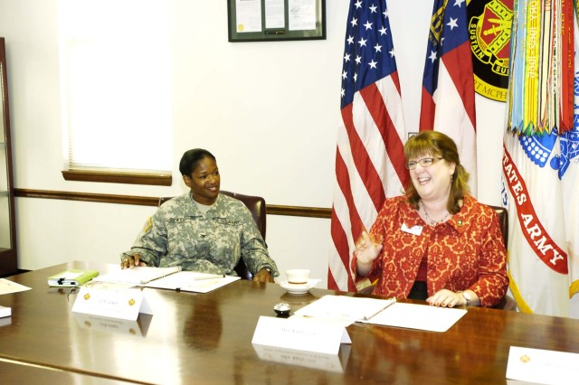 Cox shares a laugh with Col. Deborah B. Grays, U.S. Army Garrison commander, during the event.