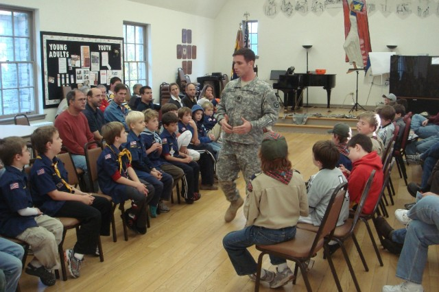 Capt. Brian E. Kinsella, a 3d Sustainment Command (Expeditionary) Soldier, and Freehold, N.J., native, speaks to Anchorage, Ky., Cub Scouts and Boy Scouts Oct. 18 about his time spent in the military and overseas. Kinsella assisted a group of Webelos from Pack 110 in earning their citizenship badges. (Courtesy photo by Gerald Oliver)""