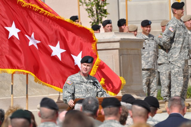 Maj. Gen. James Milano, Armor Center commanding general, addresses the audience during the activation ceremony of the Maneuver Center of Excellence, Oct. 22 at Fort Benning's Ridgway Hall. During the ceremony, Gen. Martin Dempsey, TRADOC commanding general, and Maj. Gen. Michael Ferriter, MCOE commanding general, uncased and unfurled the MCOE colors.
