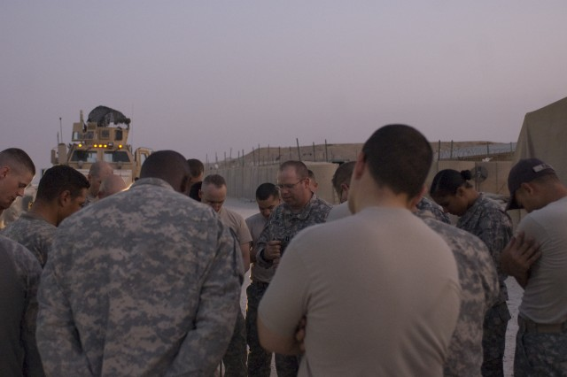 Task Force Atlas Chaplain (Capt.) Michael Lanigan, sends members of Task Force Atlas off with a prayer prior to the convoy security mission.