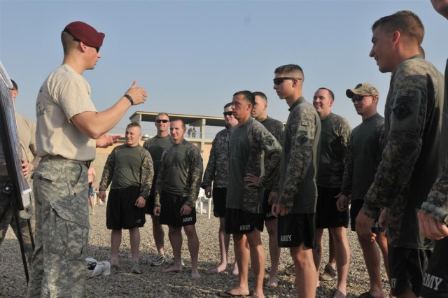 Capt. John D. Pritchard, the assistant operations officer for the 37th Engineer Battalion and a Spokane, Wash., native, conducts the manifest brief for the St. Michael's Jump Oct. 18 at the outdoor pool at Joint Base Balad, Iraq. St. Michael is the patron saint of paratroopers.