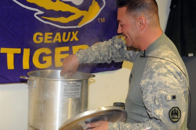 Spc. David T. Fontenot, a heavy equipment truck driver for the 1083rd Transportation Company out of Minden, La., and an Opelousas, La., native, cooks chicken and sausage gumbo for his fellow Soldiers Oct. 18, at Contingency Operating Location Speicher, Iraq.