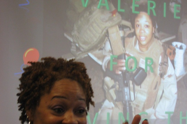 "Logistics analyst Valerie Robinson smiles during her welcome home reception after nearly a year in Iraq as a Navy reservist. ""I really, really am glad to be home,"" she says."