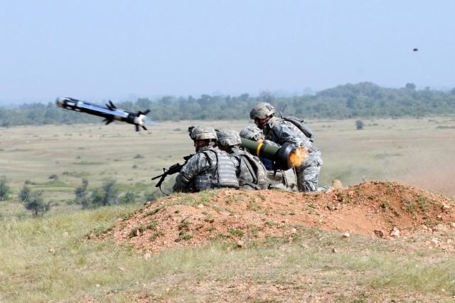 Sgt. Peter Bitter, a cavalry scout team leader and Javelin/Stryker gunner, and Sgt. Michael Resendez (left), a truck commander and Javelin gunner, both assigned to Troop B, 2nd Squadron, 14th Cavalry Regiment, 2nd Stryker Brigade Combat Team, 25th Infantry Division, complete the first Javelin missile firing in India as part of Yudh Abhyas 09 in Babina, India, Oct. 23.