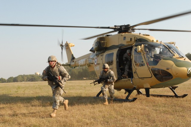 """CAMP BUNDELA, India (Oct. 23, 2009) - Soldiers assigned to 2nd platoon, Troop A, 2nd Squadron, 14th Cavalry Regiment """"Strykehorse,"""" 2nd Stryker Brigade Combat Team, 25th Infantry Division, from Schofield Barracks, Hawaii, exit a helicopter flown by Indian Army aviators from the 201st Army Aviation Squadron. The Soldiers were conducting static load training with the Advanced Light Helicopter, an Indian-made helicopter, during Exercise Yudh Abhyas 09, a bilateral exercise involving the Armies of India and the United States."""