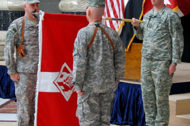 Maj. Gen Michael Eyre, left, and Cmd. Sgt. Maj. Mitch Prater prepare to case the U. S. Army Corps of Engineers Gulf Region Division colors during an inactivation ceremony in Baghdad. As part of the responsible drawdown of U.S forces in Iraq, the Gulf Region Division is the first division headquarters to leave the Iraqi theater.