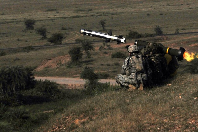 """Camp Bundela, India - Under the instruction of a Soldier assigned to the 2nd Squadron, 14th Cavalry Regiment, """"Strykehorse,"""" 2nd Stryker Brigade Combat Team, 25th Infantry Division, an Indian Army Soldier assigned to the 31st Armored Division fires a Javelin missile Oct. 24 as part of Exercise Yudh Abhyas 09. This is the first time an Indian Army Soldier has fired the Javelin weapon system."""