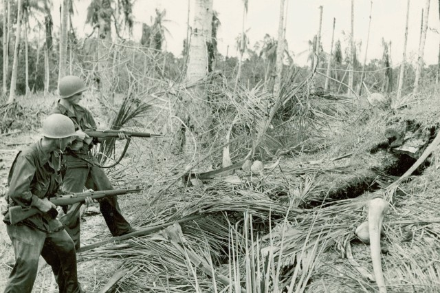 """Clearing out the vipers nest: """"American Soldiers clearing a Japanese bunker near Buna, New Guinea"""" (World War II Signal Corps Photograph Collection)."""
