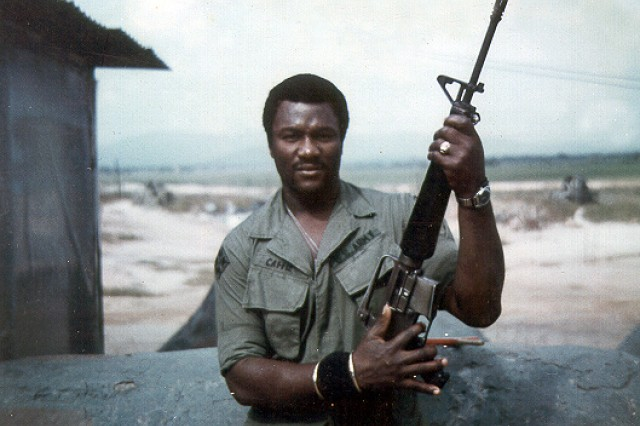 Leon E. Caffie poses with his M-16 in Dak Tho, Vietnam in 1970. The young draftee is now Command Sergeant Major Caffie and finishing his military career as the top enlisted Soldier in the Army Reserve.