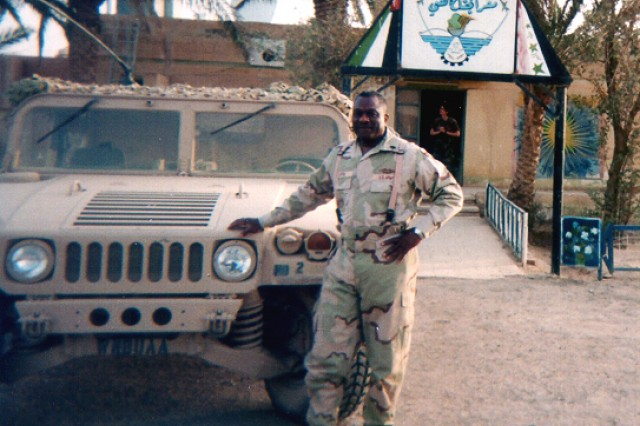 Command Sgt. Maj. Leon E. Caffie stands outside his unit's headquarters in Talil, Iraq, in 2003. The Army Reserve's 377th Theater Support Command handled logistics for Operation Iraqi Freedom.