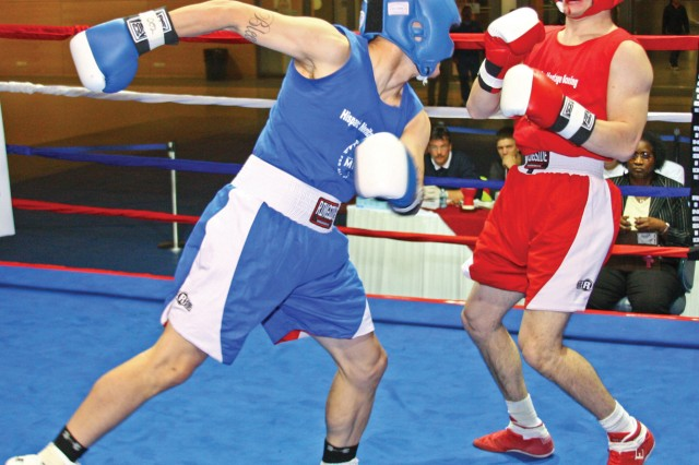 Kevin Forst, Mannheim, draws back to set up a blow against Mark Webb, Wiesbaden, during Welterweight action at the Hispanic Heritage Boxing Tournament in Wiesbaden