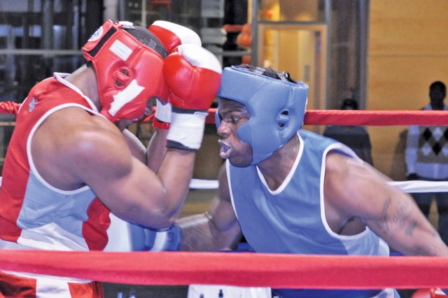 Daine Watson, Wiesbaden, delivers a combination of punches to the body of Ronand Grant during the final Super Heavyweight bout at Wiesbaden's Hispanic Heritage Month Boxing Tournament.