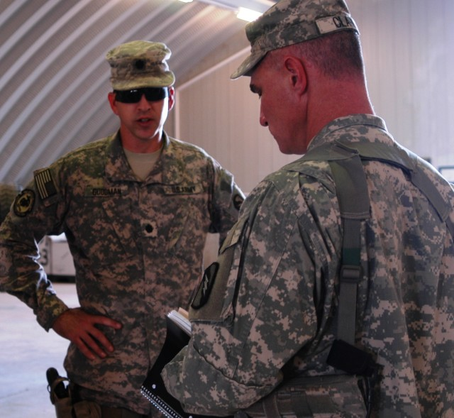 CONTINGENCY OPERATING LOCATION Q-WEST, Iraq - Lt. Col. Kerry Goodman (left) of Meridian, Miss., discusses results of an Oct. 11 excess inventory inspection with Capt. Drew Clark of Madison, Miss., who prepares to take notes. Goodman commands 2nd Batt...