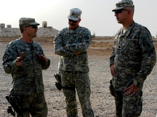 CONTINGENCY OPERATING LOCATION Q-WEST, Iraq - Sgt. 1st Class Randolph Dover (left), a motor sergeant from Sardis, Miss., and 1st Sgt. John L. Beasley (middle), native of Henando, Miss., both of Company A, 2nd Battalion, 198th Combined Arms out of Her...