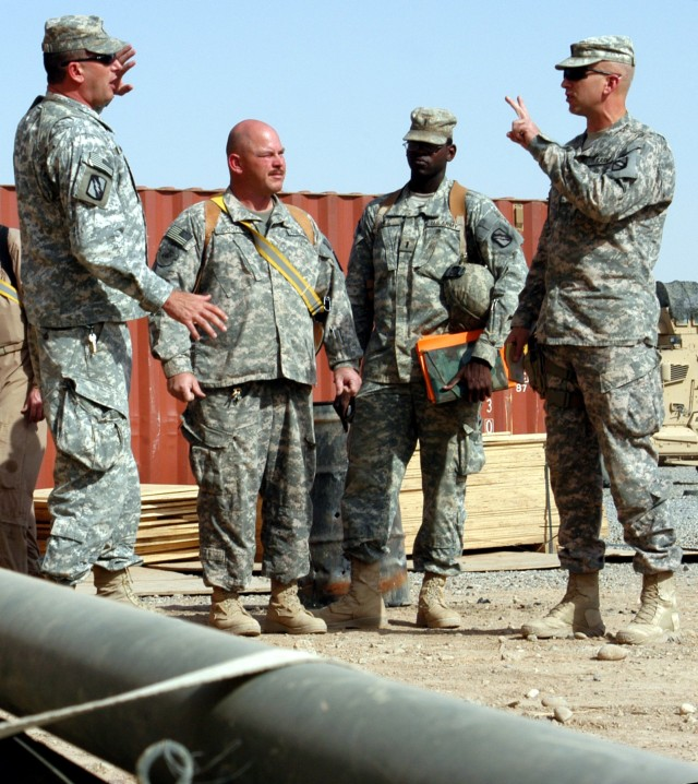 CONTINGENCY OPERATING LOCATION Q-WEST, Iraq - From left to right, 1st Sgt. John Moyer, of  Senatobia, Miss., Sgt. 1st Class Wilton R. Cooper, motor sergeant from Mantachie, Miss, and 1st Lt.  Jesse Hill, Jr., executive officer from Meridian, Miss., a...