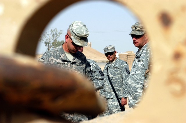 CONTINGENCY OPERATING LOCATION Q-WEST, Iraq - Seen through the tow ring of an Armored Security Vehicle, Lt. Col. Kerry Goodman (left), a native of Meridian, Miss., and commander 2nd Battalion 198th Combined Arms headquartered in Senatobia, Miss., tak...