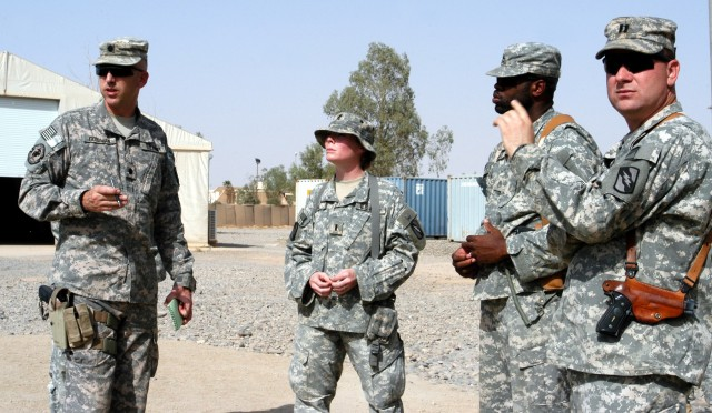 CONTINGENCY OPERATING LOCATION Q-WEST, Iraq - Lt. Col. Kerry Goodman (left), a native of Meridian, Miss., and commander of 2nd Battalion, 198th Combined Arms headquartered in Senatobia, Miss., reviews the motor pool of Company A, 106th Brigade Suppor...