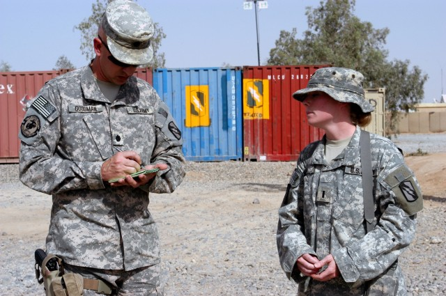 CONTINGENCY OPERATING LOCATION Q-WEST, Iraq - During an excess property inspection here, Lt. Col. Kerry Goodman (left), a native of Meridian, Miss., and commander of 2nd Battalion, 198th Combined Arms headquartered in Senatobia, Miss., notes issues i...