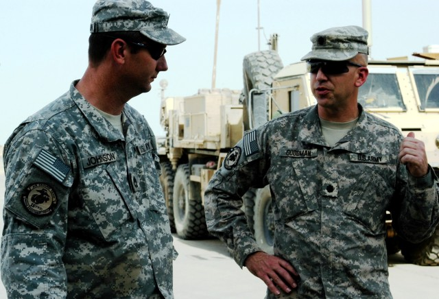 CONTINGENCY OPERATING LOCATION Q-WEST, Iraq - Sgt. 1st Class Bradley Johnson (left), native of Brookhaven, Miss., and motor sergeant for Company A, 106th Brigade Support Battalion (Attached), out of Magee, Miss., listens to guidance from Lt. Col. Ker...