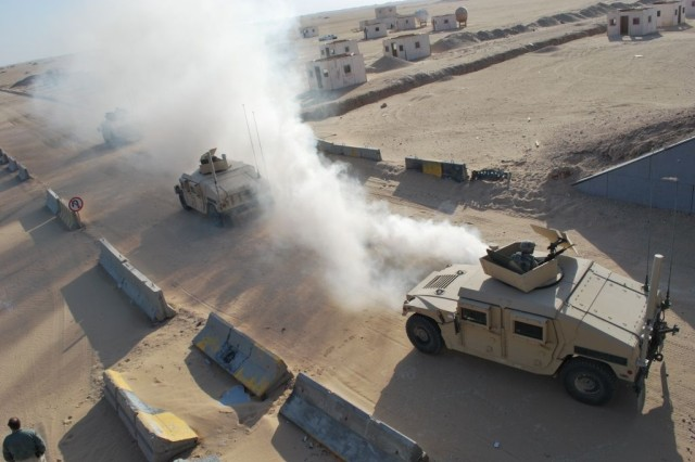 Soldiers of Company G, 203rd Brigade Support Battalion, 3rd Heavy Brigade Combat Team, 3rd Infantry Division, attached to the 1st Battalion, 10th Field Artillery, conduct convoy training Oct. 20 at Camp Buehring, Kuwait. Much of the training performed at Camp Buehring was designed to teach Soldiers the proper techniques during hazardous conditions they might face in Iraq. (courtesy photo, Company G, 203rd BSB)