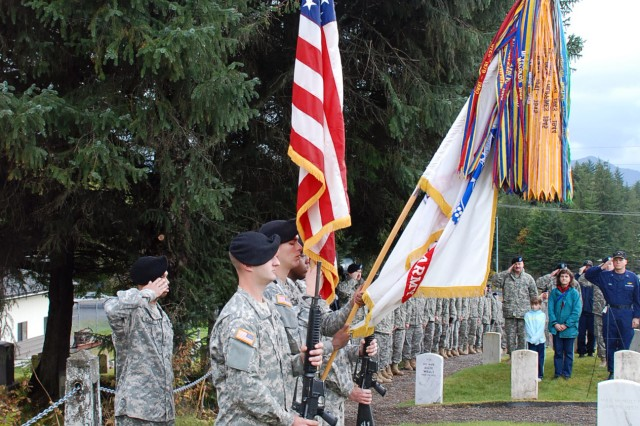 """Soldiers from the 95th Chemical Company present the colors as Taps is played Oct. 18 during  a ceremony honoring fallen service members at Sitka National Cemetery in Sitka, Alaska."""""""