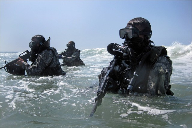 Soldiers perform a seaborne infiltration as part of training at the Special Forces Underwater Operations School in Key West, Fla. The four-week Combat Diver Qualification Course, run by the U.S. Army John F. Kennedy Special Warfare Center and School, trains qualified combat divers in a variety of waterborne operations.