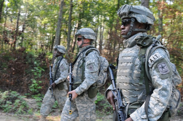 A group of Reserve civil affairs Advanced Individual Training Soldiers march through the backwoods of Camp Mackall, N.C., while taking part in Operation Certain Trust. The Soldiers were en route to a bridge assessment project to ensure they could support coalition forces.